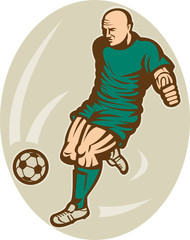 Soccer player kicking the ball front