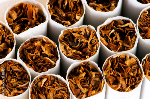 Close up of smoking cigarettes as antismoking concept