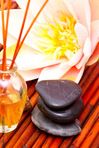 Spa oils, massage stones and lotus