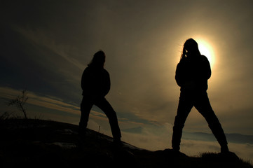 Silhouette of rockers in the darkness