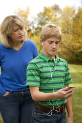 Son Ignoring Mother, Listening to Music Player