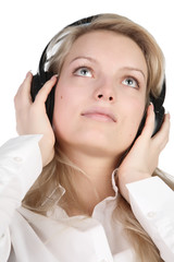 beautiful girl on light background in ear-phones