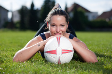 Attractive female with a football
