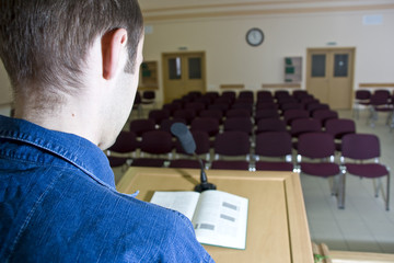 Speaker at work and empty auditorium