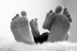 Close up of newborn and mother feet