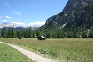 Walking between the barns of Corvara