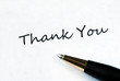 Ball pen on white background showing Thank You