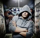 Fototapety Cool looking hooligan in a graffiti painted gateway