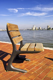 A single seat on the river bank in Rotterdam