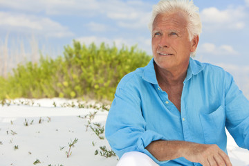 Outdoor Portrait of An Attractive Handsome Senior Man At Beach