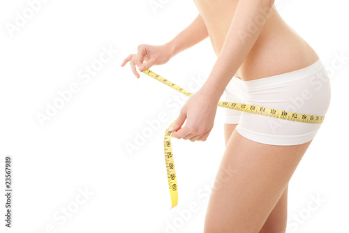 Athletic woman with measure tape