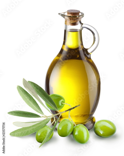 Leinwandbild Motiv Branch with olives and a bottle of olive oil isolated on white