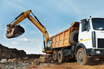 Excavator and dumper at loading works