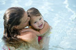 Mother with young girl in swimming pool