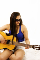 Pretty girl playing guitar, with copy space