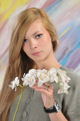 Portrait of beautiful girl with white orchid