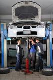 Auto mechanics working under the car - a series of MECHANIC