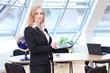 Blonde female office employee