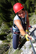 Young smiling woman climbing in the nature