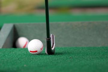 golf ball with a stick