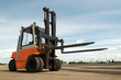 canvas print picture - Forklift loader for warehouse works outdoors with risen forks