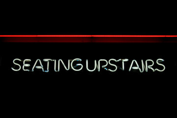 SEATING UPSTAIRS neon sign