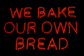 WE BAKE OUR OWN BREAD neon sign