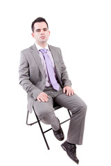Young business man sitting on a chair