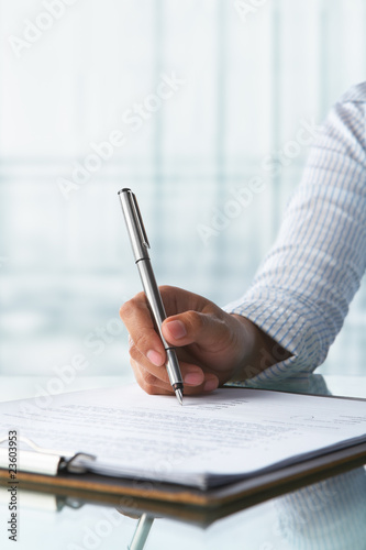 Businesswoman signing paper