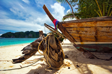 Old Thai boat at the beach. Phi Phi island. Thailand