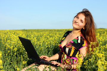 Young woman with laptop outdoor