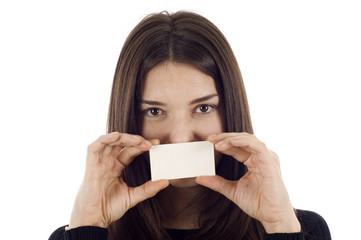 Woman covering her face with a blank business card
