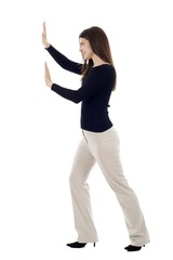 Woman pushing an imaginary object isolated