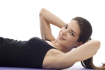 Exercise - A woman in gym clothes, doing sit-ups
