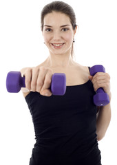 Smiling Fit Woman Doing Dumbbell Exercise