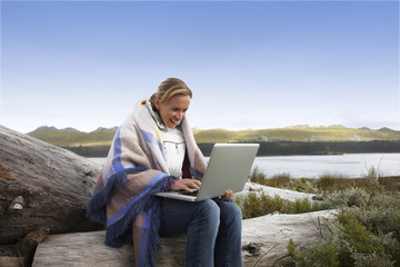 Woman with a laptop in the countryside
