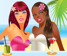 Two beautiful women with cocktails on the beach