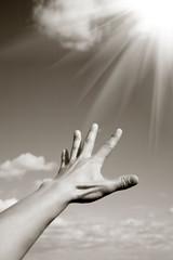 Man's hand reaching the heaven