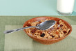 bran and raisin cereal with spoon