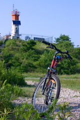 bike and lighthouse with solar battery