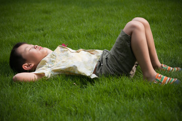 Sleeping on the grass boy