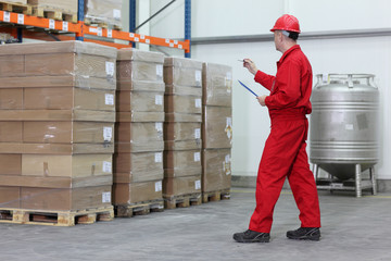 worker counting stocks in a company warehouse