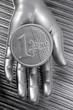 euro silver coin of futuristic metallic silver hand
