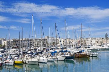Yachts moored in Trani touristic port. Apulia.