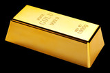 Gold bar isolated on black