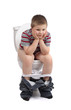 Little boy is sitting on toilet