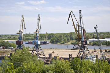 Cargo terminal for ships and barges on the river bank.
