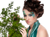 Close-up of sprite girl with faceart and plant poster