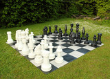 big outdoor chess in green lawn poster