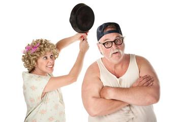 Woman swinging frying pan at husband